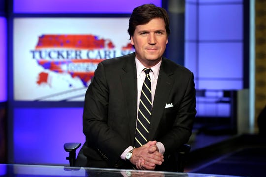 "FILE - In this March 2, 2017 file photo, Tucker Carlson, host of ""Tucker Carlson Tonight,"" poses for photos in a Fox News Channel studio, in New York. Carlson said Wednesday, March 13, 2019, he's scuttling plans for a TV studio near his vacation home in rural Maine. (AP Photo/Richard Drew, File)"