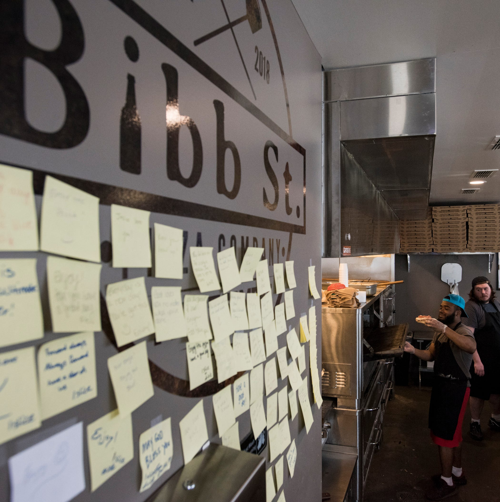 At Bibb St. Pizza restaurant, people buy meals, leave notes for homeless
