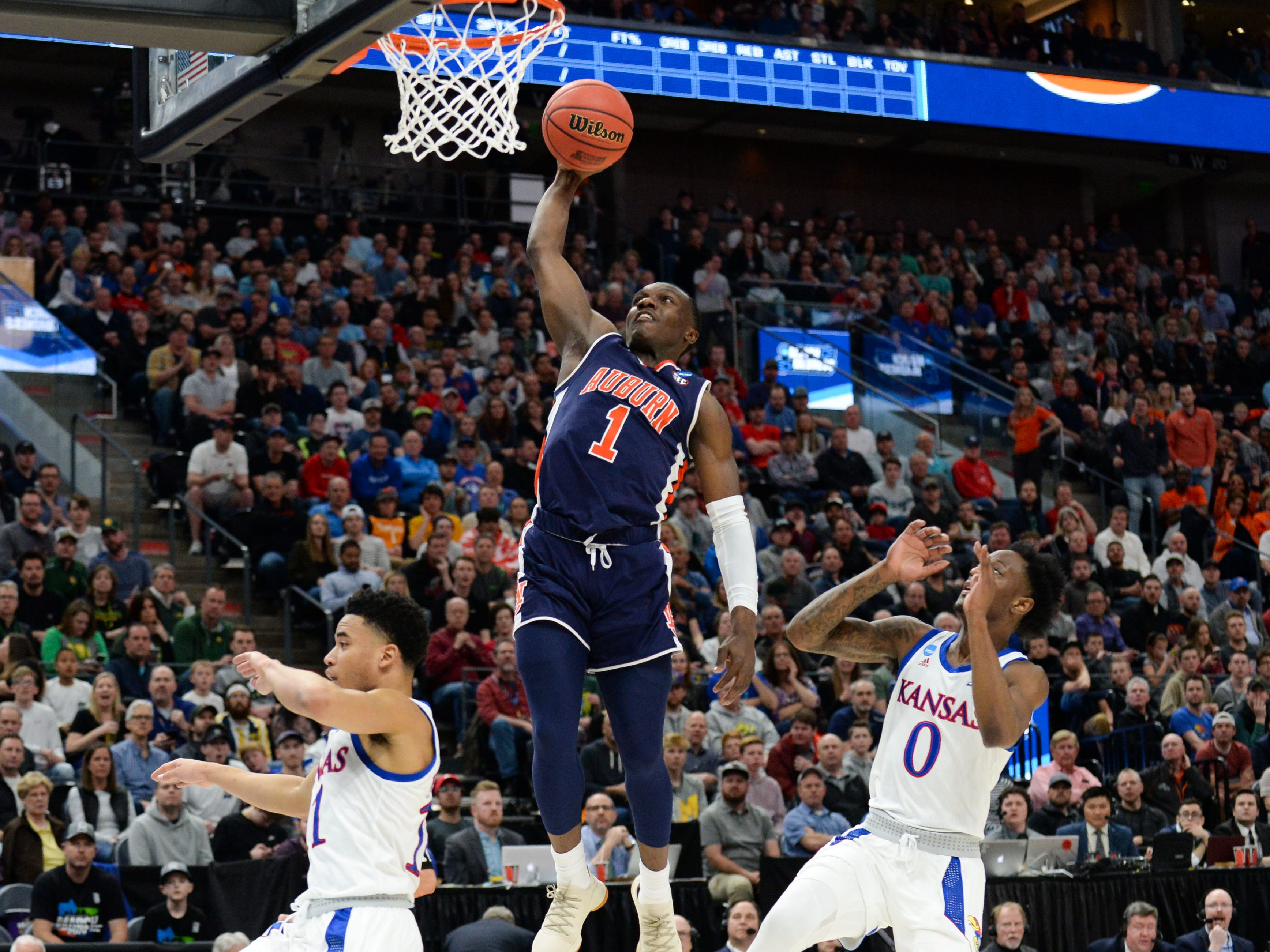 Auburn Jared Harper (1) goes up for a basket ahead of Kansas guard Marcus Garrett (0) during the NCAA Tournament at Vivint Smart Home Arena on March 23, 2019, in Salt Lake City.
