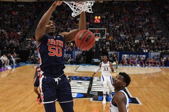 Auburn center Austin Wiley (50) dunks as Kansas guard Ochai Agbaji (30) looks on during the NCAA Tournament at Vivint Smart Home Arena on March 23, 2019, in Salt Lake City.