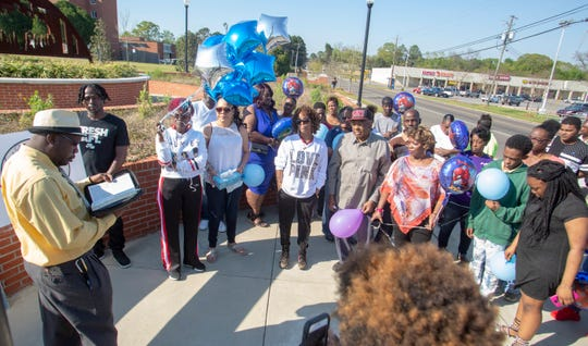 Tosha Webster gathered family and friends to remember her son, Azariah Baldwin, and his friend, Demond Moore, and Moore's father, John Moore, who were all killed in a wreck a year ago.