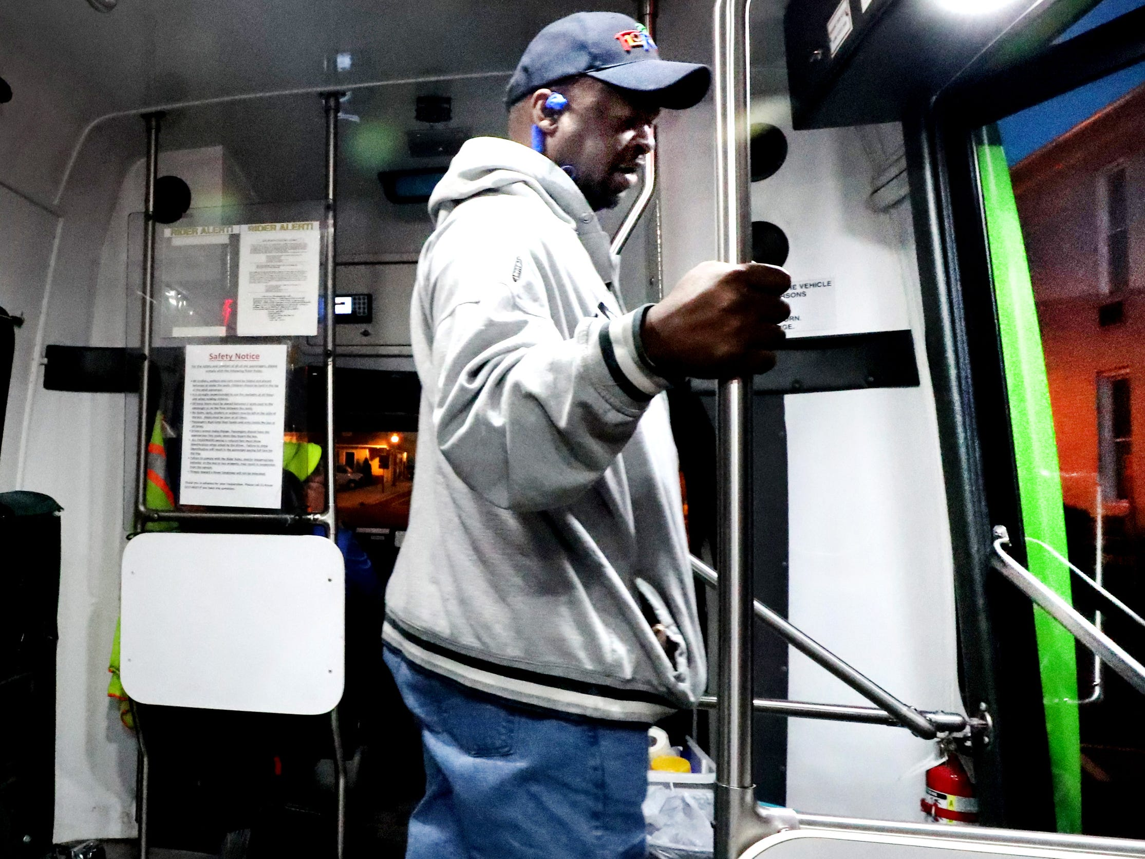 Joel Hicks gets off the 6 am bus as he goes to work at City Cafe in downtown Murfreesboro, on Tuesday, March 19, 2019. Many people rely on the Murfreesboro bus service Rover to get back and forth to their jobs.