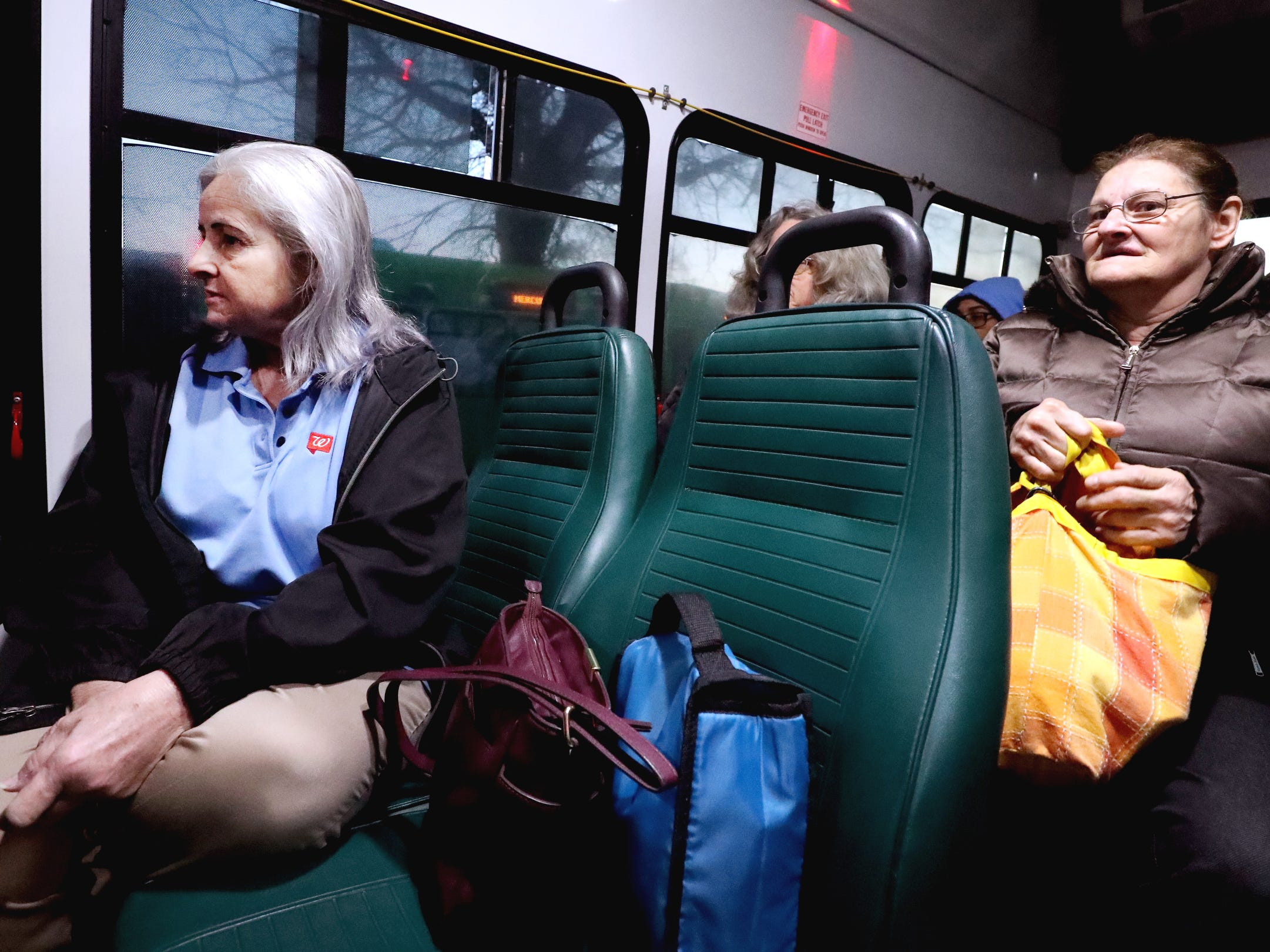 Mindy Hughes rides the Rover bus to go to work at Walgreens, on Tuesday, March 19, 2019. Many people rely on the Murfreesboro bus service Rover to get back and forth to their jobs. Charlotte Huntley rides to work behind Hughes.