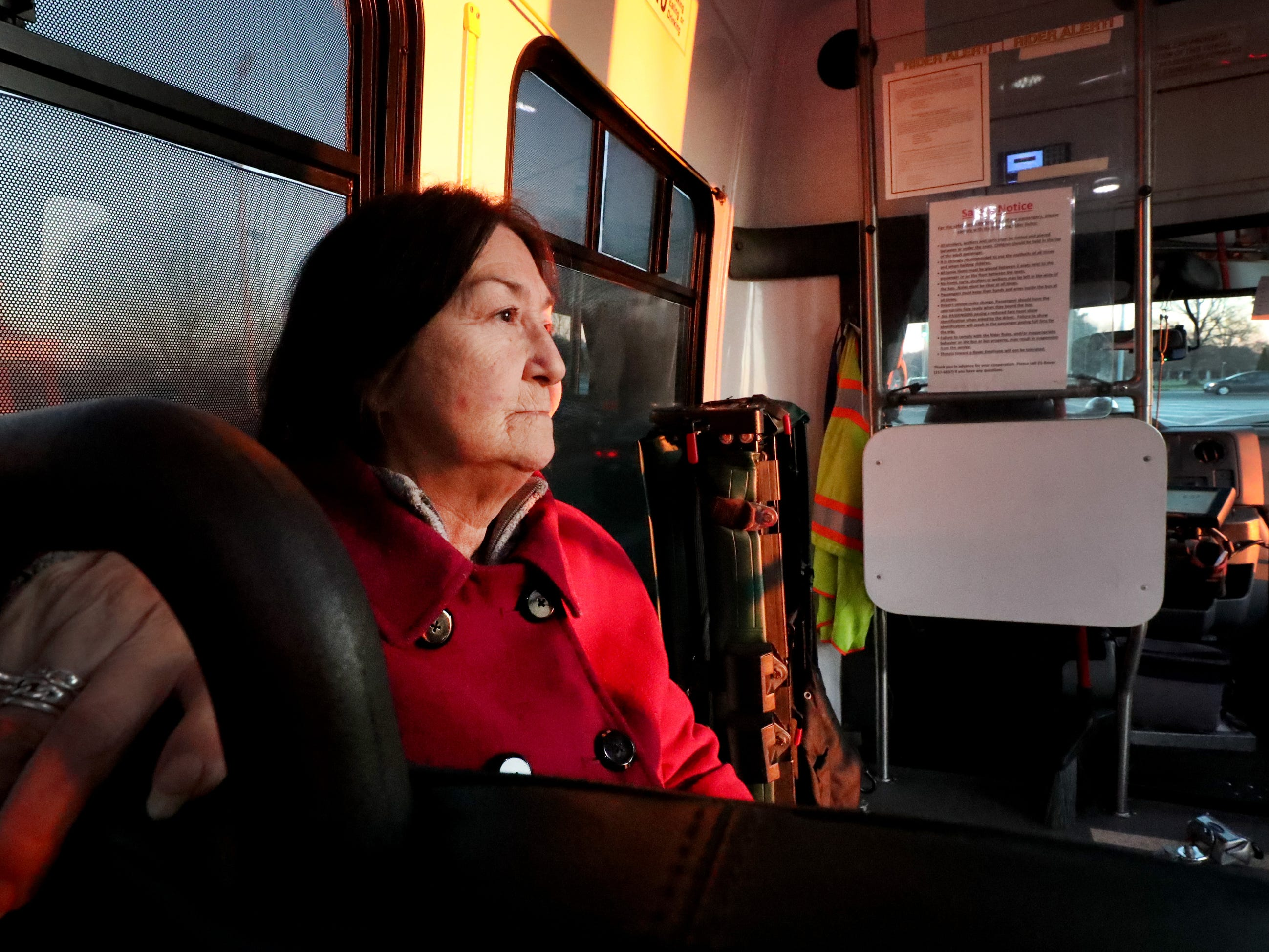 Cristina Coffman walks several streets to get to the bus stop to go to work. Many people rely on the Murfreesboro bus service Rover to get to their jobs.