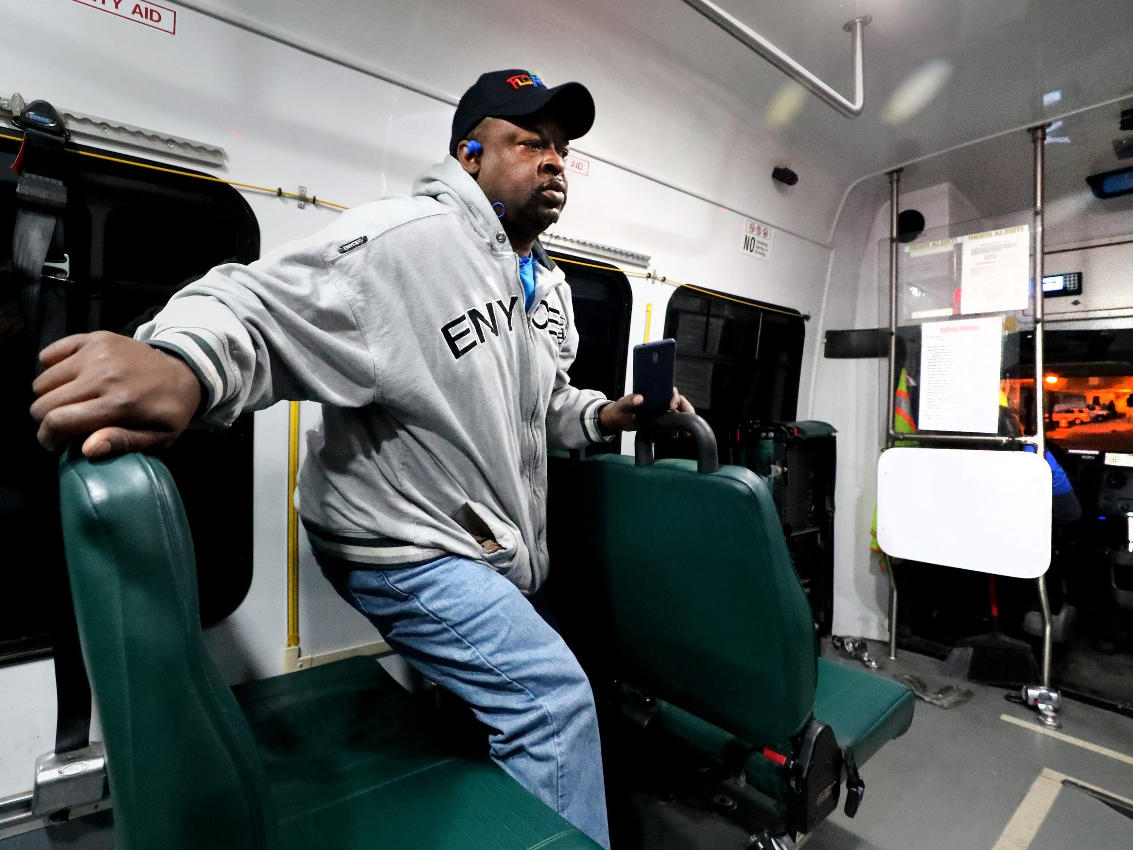 Joel Hicks stands up to get off the 6 am bus as he goes to work at City Cafe in downtown Murfreesboro, on Tuesday, March 19, 2019. Many people rely on the Murfreesboro bus service Rover to get back and forth to their jobs.