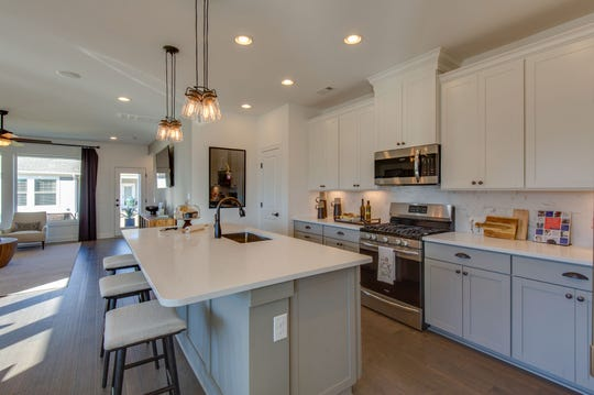The large kitchen island has room for food preparation and dining.