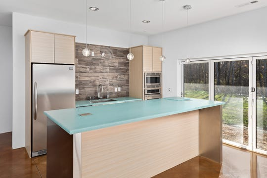 The daylight basement features a full kitchen that opens to the backyard.