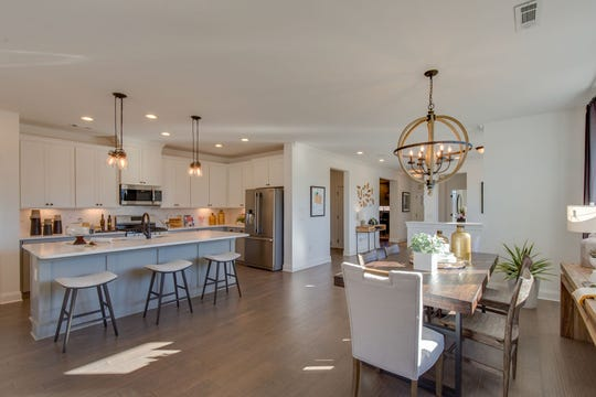 The open kitchen and dining area is perfect for entertaining.