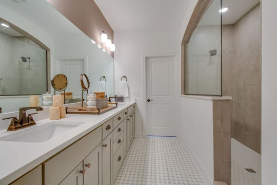 The master bath has a twin-sink vanity and a super shower.