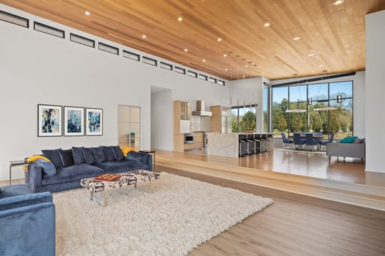 This view shows the home's massive open kitchen, dining and living rooms.