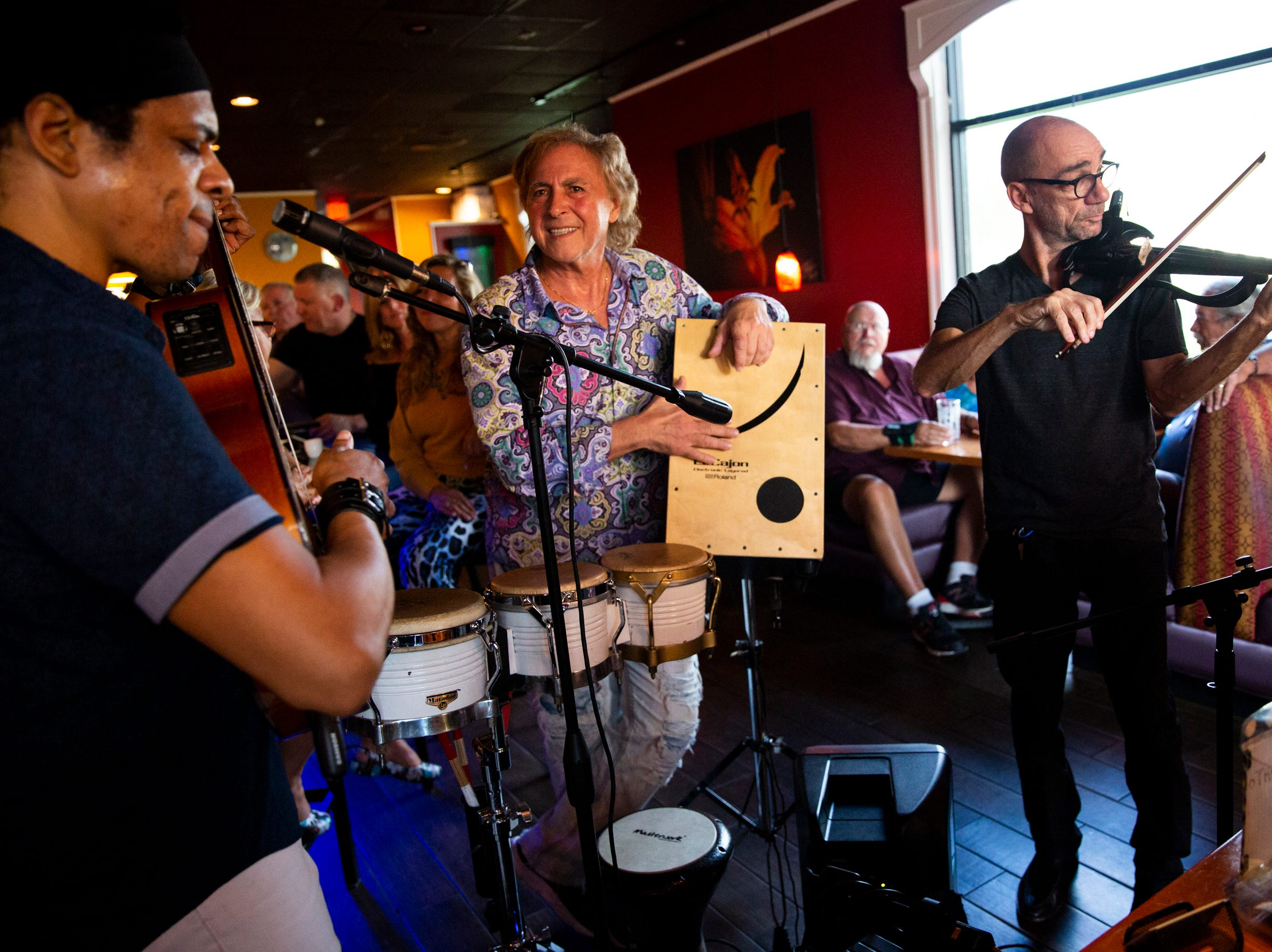 Naples Philharmonic violinist Boris Sandler, right, performs with El Gato Solea and the Flamenco Fusion at Komoon Thai Sushi and Ceviche in Naples on Sunday, March 24, 2019.
