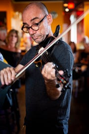 Naples Philharmonic violinist Boris Sandler performs with El Gato Solea and the Flamenco Fusion at Komoon Thai Sushi and Ceviche in Naples on Sunday, March 24, 2019.
