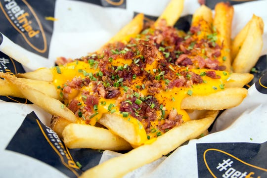 Texas Cheese Fries include bacon, drizzled cheese, chives and chili powder at #GetFried Fry Cafe.