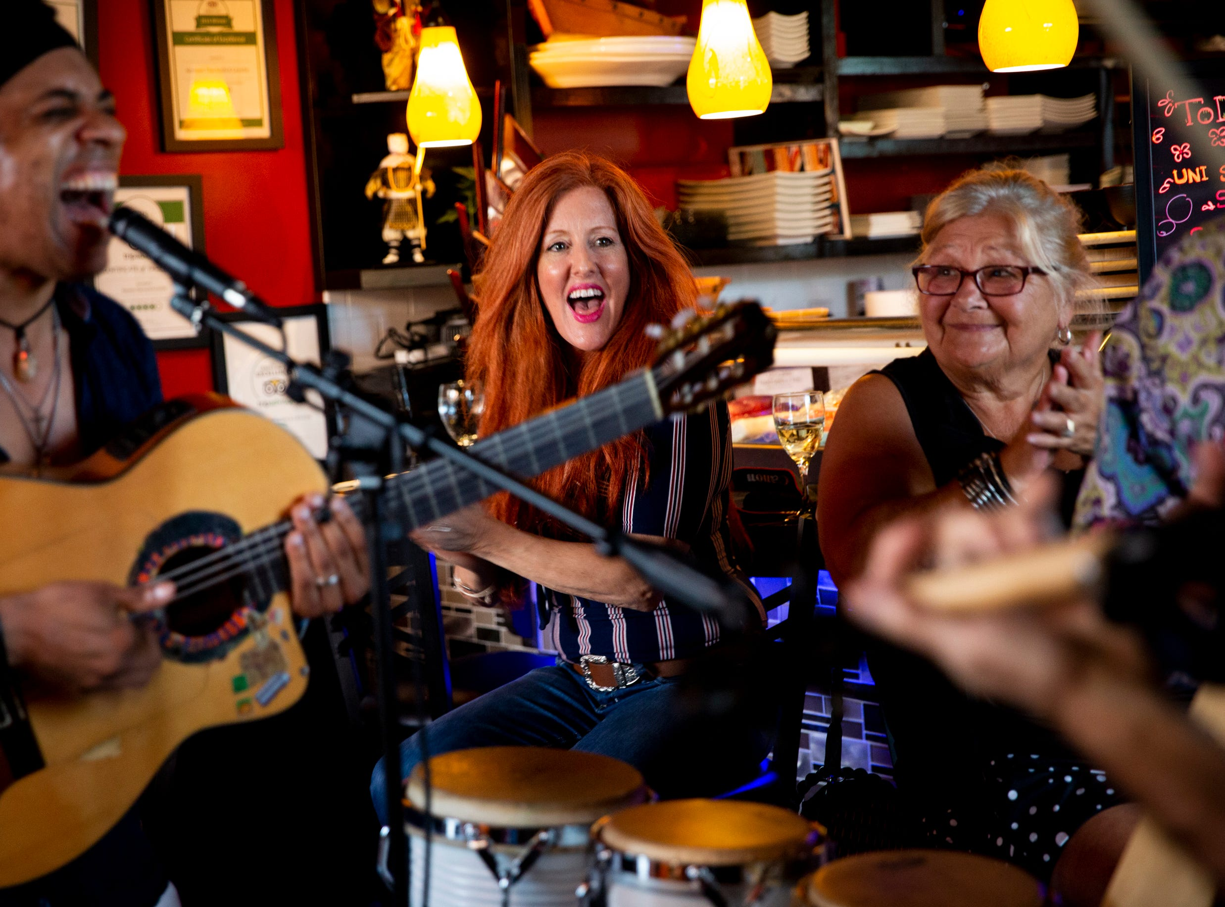 Shelly Renee Davis, left, and Danielle Gagmé, right, cheer and clap as they watch a performance by El Gato Solea and the Flamenco Fusion at Komoon Thai Sushi and Ceviche in Naples on Sunday, March 24, 2019.