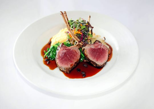 KC American Bistro's Rosemary and Mint Marinated Lamb Chops with goat cheese polenta, roasted fennel and sautéed garlic spinach with Morello cherry demi-glace. The local restaurant's second location is targeted to open in mid-May 2019 in University Village Shops near FGCU.
