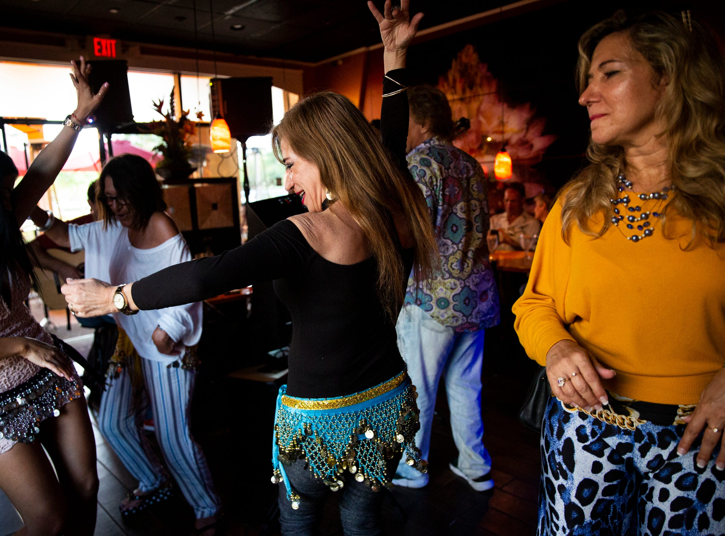 Nella Nugent, center, dances during a performance by El Gato Solea and the Flamenco Fusion at Komoon Thai Sushi and Ceviche in Naples on Sunday, March 24, 2019.