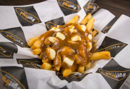 Poutine is one of the smothered-fries options at #GetFried Fry Cafe in Estero.
