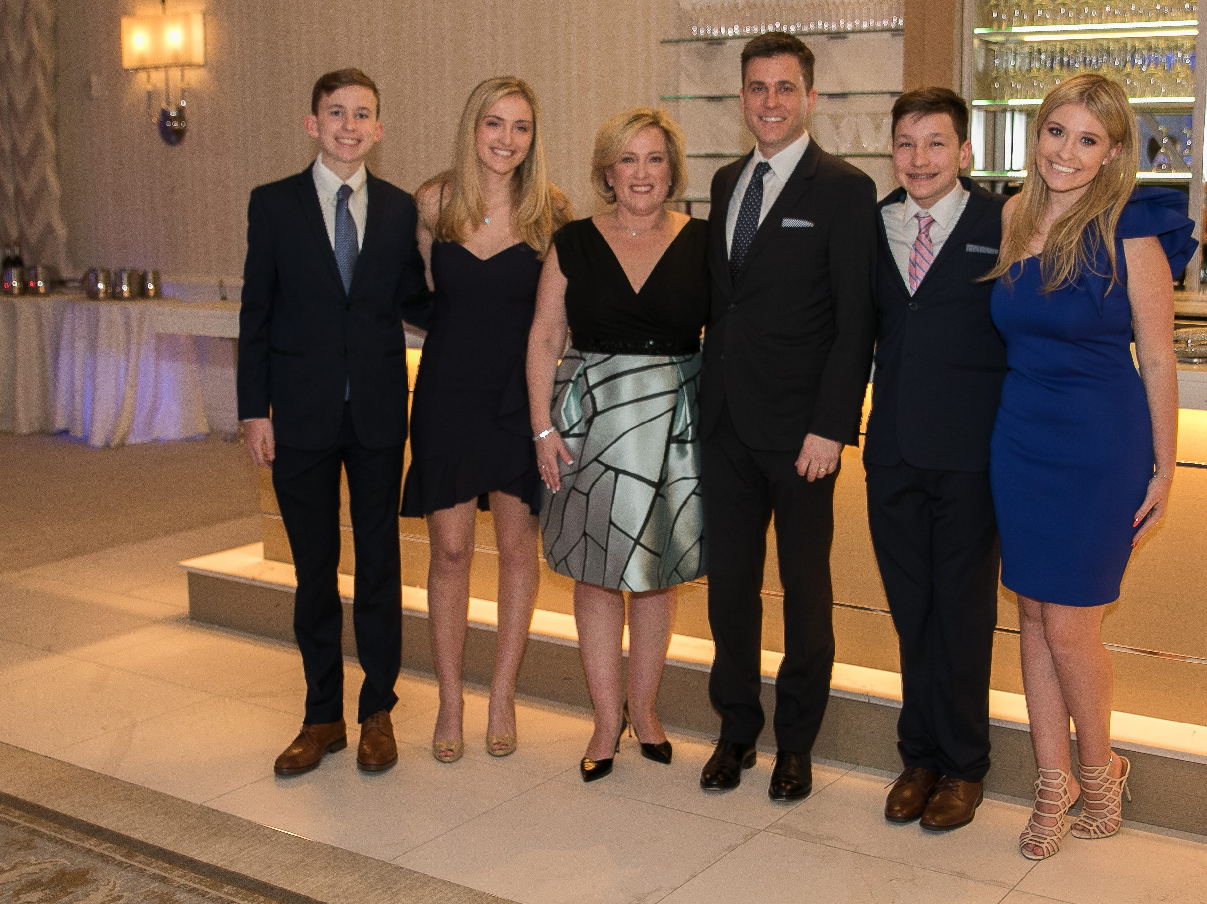 Honoree- Colleen Corbett Staff with her husband and children. Academy of The Holy Angels held their 22nd annual Angelic Evening at Edgewood Country Club in RiverVale. 03/22/2019