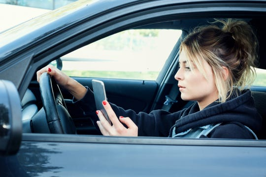 A new Tennessee law makes using hand-held cellphones illegal while driving.