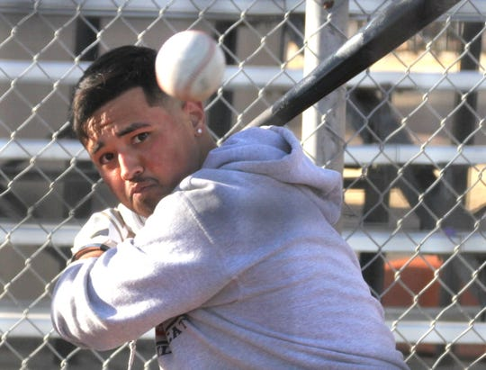 Junior Wildcat James Palomarez is seeing the ball well during batting practice.