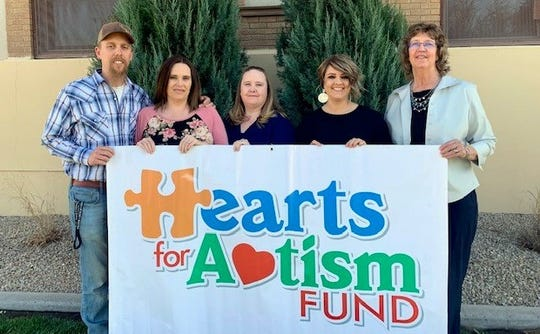 From left are organizers for the Hearts for Autism second annual Autism Awareness Walk, Daniel Gonzales, Crystal Gonzales, Carissa Teeter, Lisa Perez and Beth Boggs.