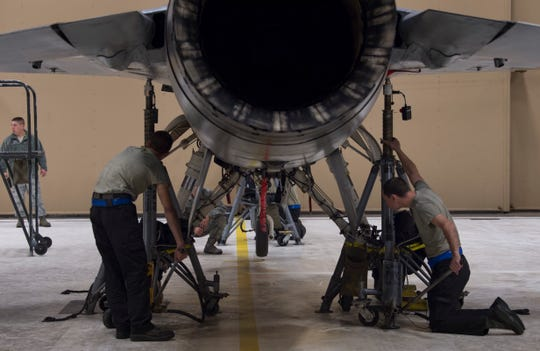 Airmen from the 311th Aircraft Maintenance Unit use a jack to raise an aircraft during a weight and balance check, March 11, 2019, on Holloman Air Force Base, N.M. A weight and balance check is performed on an aircraft every three years, and is necessary for the aircraft to maintain the correct balance for flight.