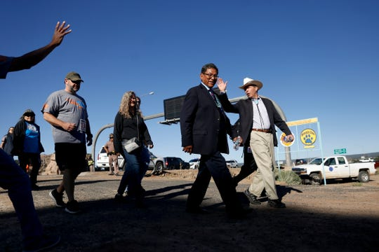 From right, Sen. Tom Udall, D-N.M, joins Navajo Nation President Russell Begaye in a morning walk to commemorate the 150th anniversary of the Navajo Nation Treaty of 1868, Friday, June 1, 2018 in Window Rock, Arizona.