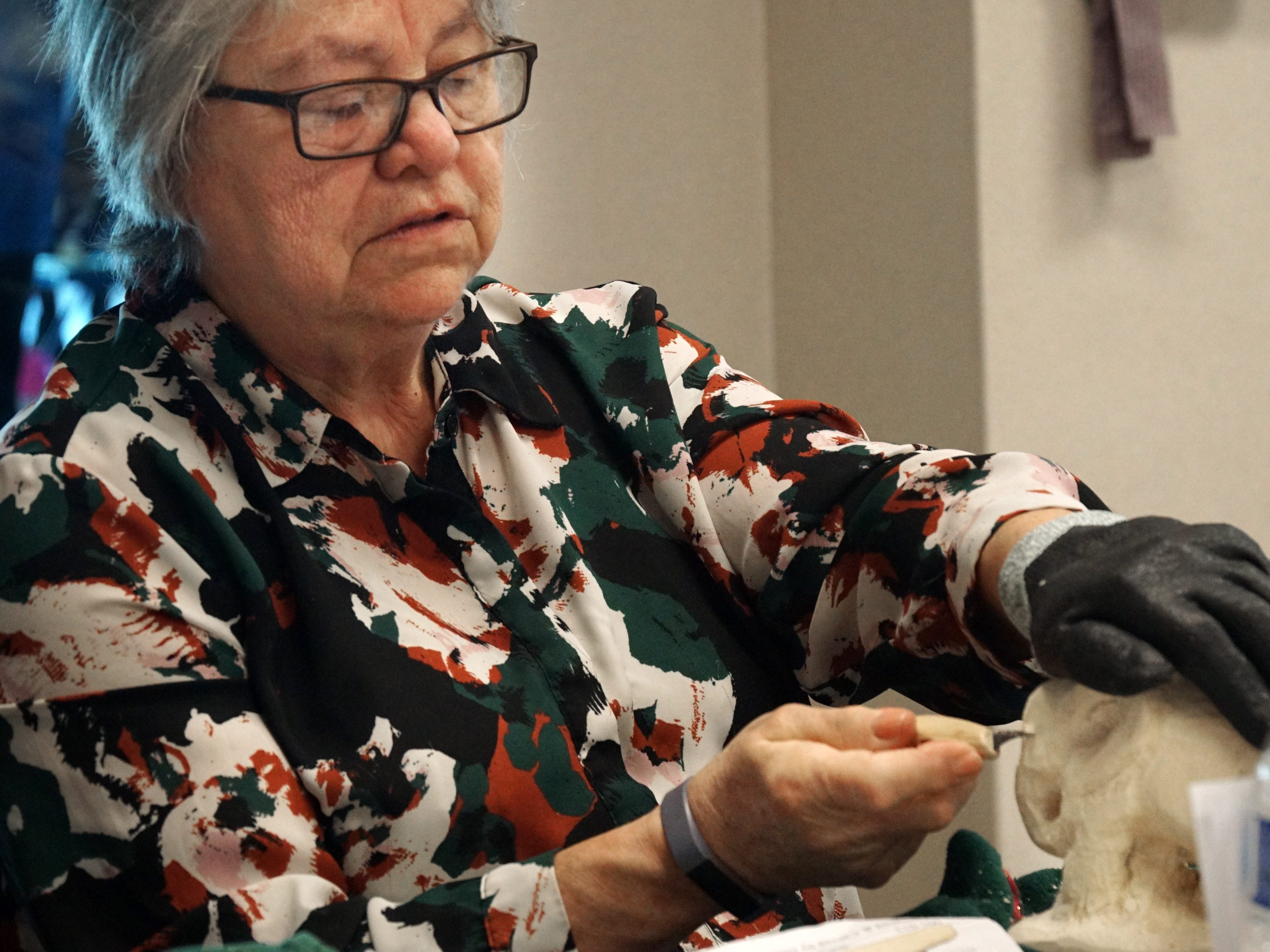 Lucy Hockin works on carving an elephant during the March 25 meeting.