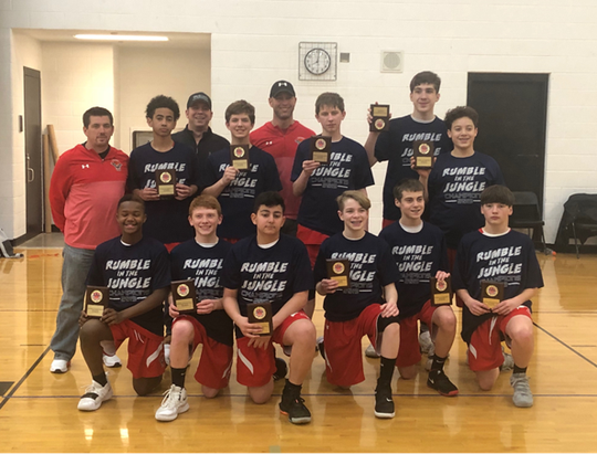 The 8th grade Livonia Hawks basketball team won the Rumble in the Jungle tournament.