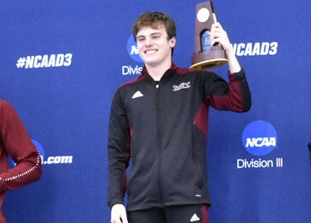 South Lyon native Jay Lang celebrates his national title in the 3-meter board.