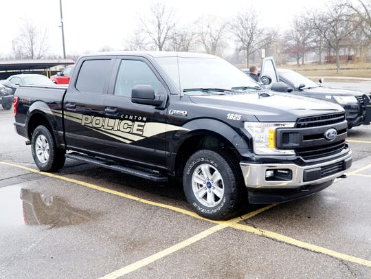 """The Canton Police Department has been using to Ford F-150 trucks in the past year for routine patrol and highway traffic and weight enforcement. This model sports """"ghost graphics"""" which only show up when hit with a flash unit (as seen here) or when a car's lights hit them. They appear, out of the light, as otherwise unmarked police vehicles."""