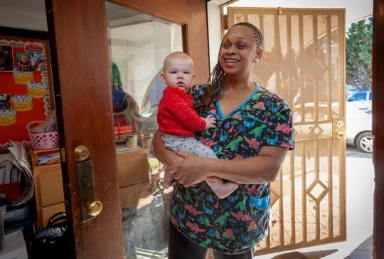 Nancy Harvey, owner of Lil Nancy's Primary, holding Sam.