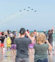 Hundreds of people crowd the beach to get a glimpse of the Blue Angels as they fly over Pensacola Beach on Monday, March 25, 2019. A $5 drawing donation could win participants a four-day, three-night stay at Hilton Pensacola Beach, 12 Via De Luna Drive, for the July 11 through 13 Blue Angels Airshow.