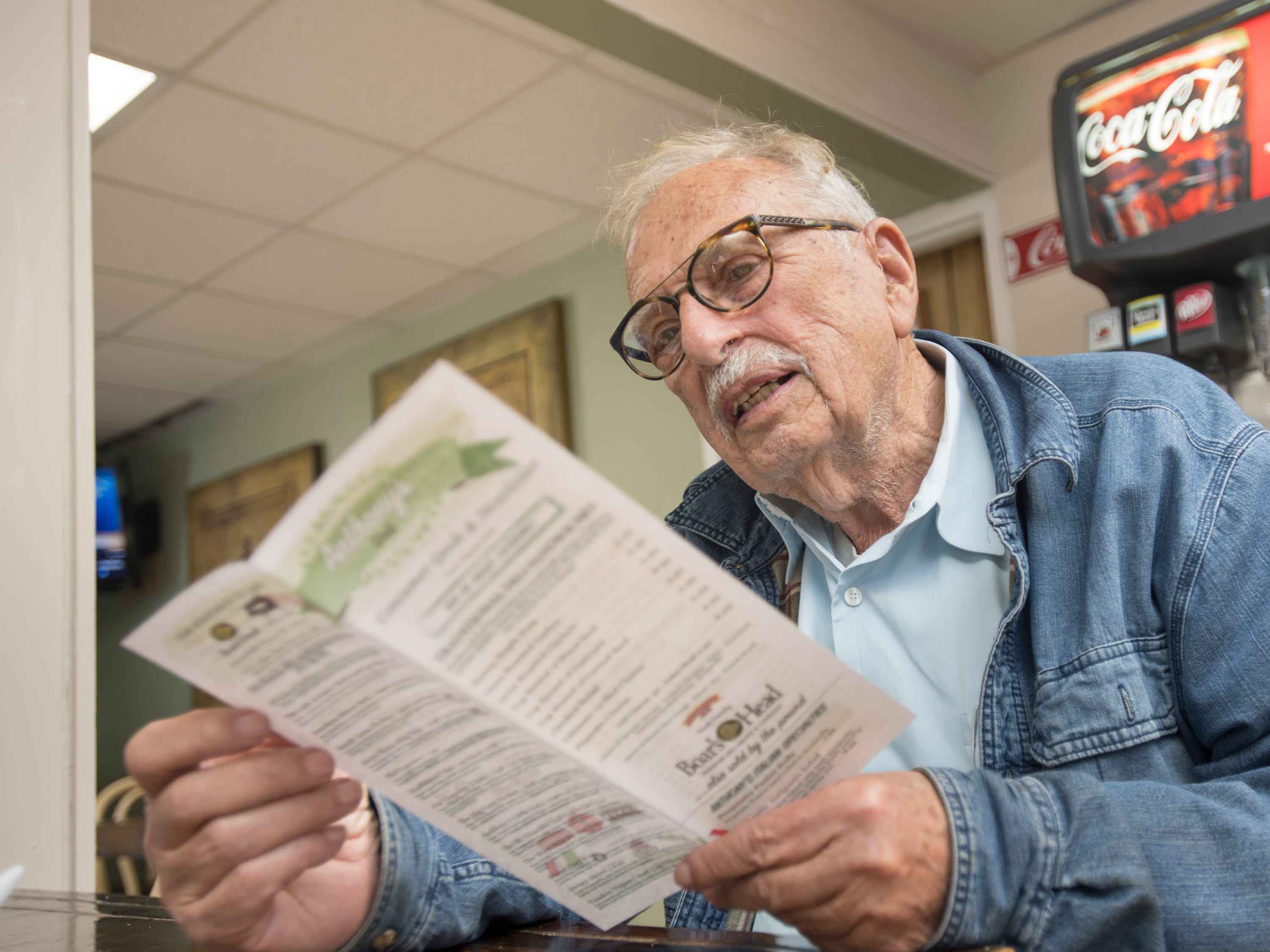 Don Fabini looks over the menu at Anthony's Deli on Lilian Highway in Pensacola on Monday, March 25, 2019.
