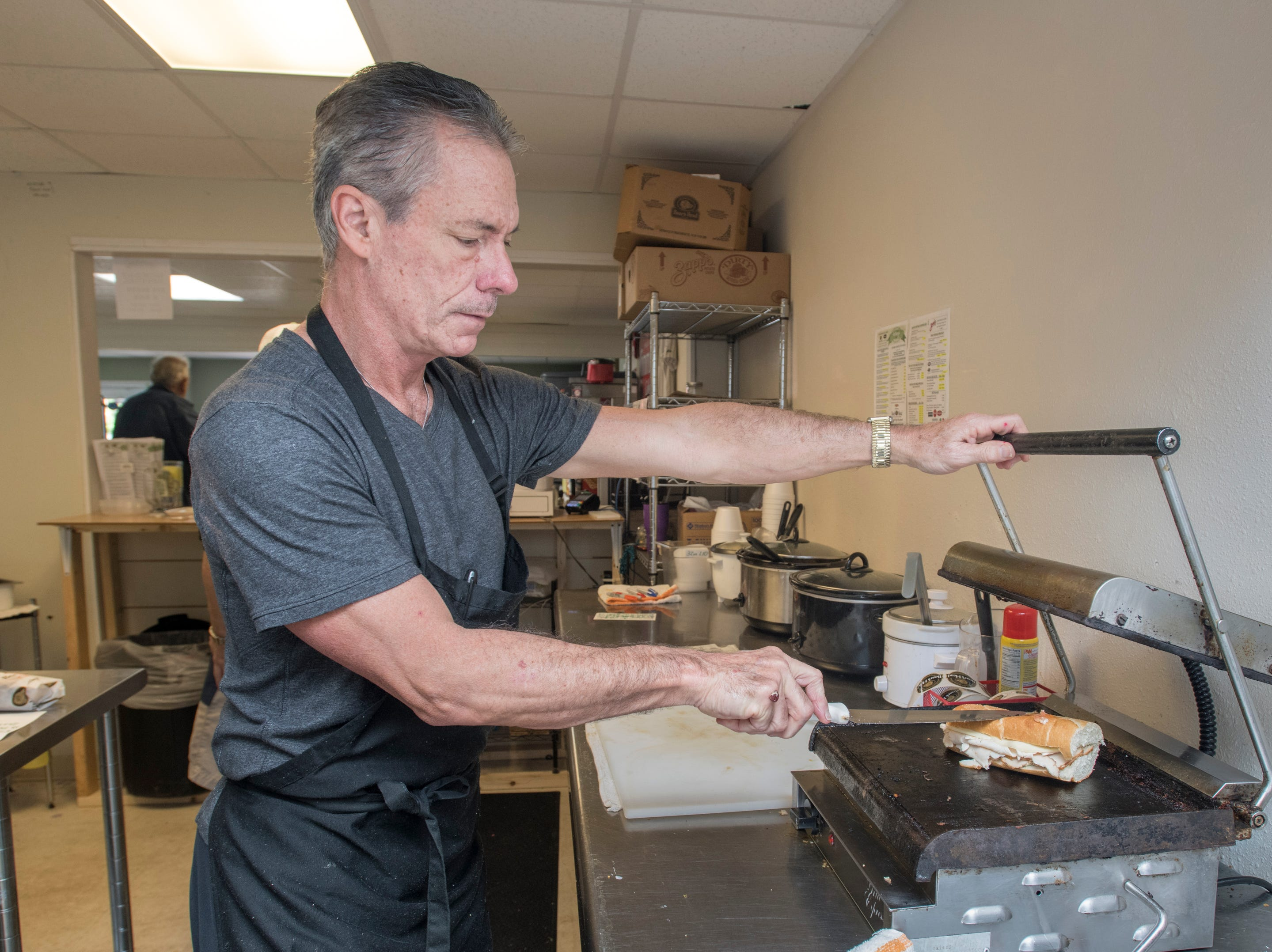 Owner Mike Lutts grills a sub at Anthony's Deli on Lilian Highway in Pensacola on Monday, March 25, 2019.