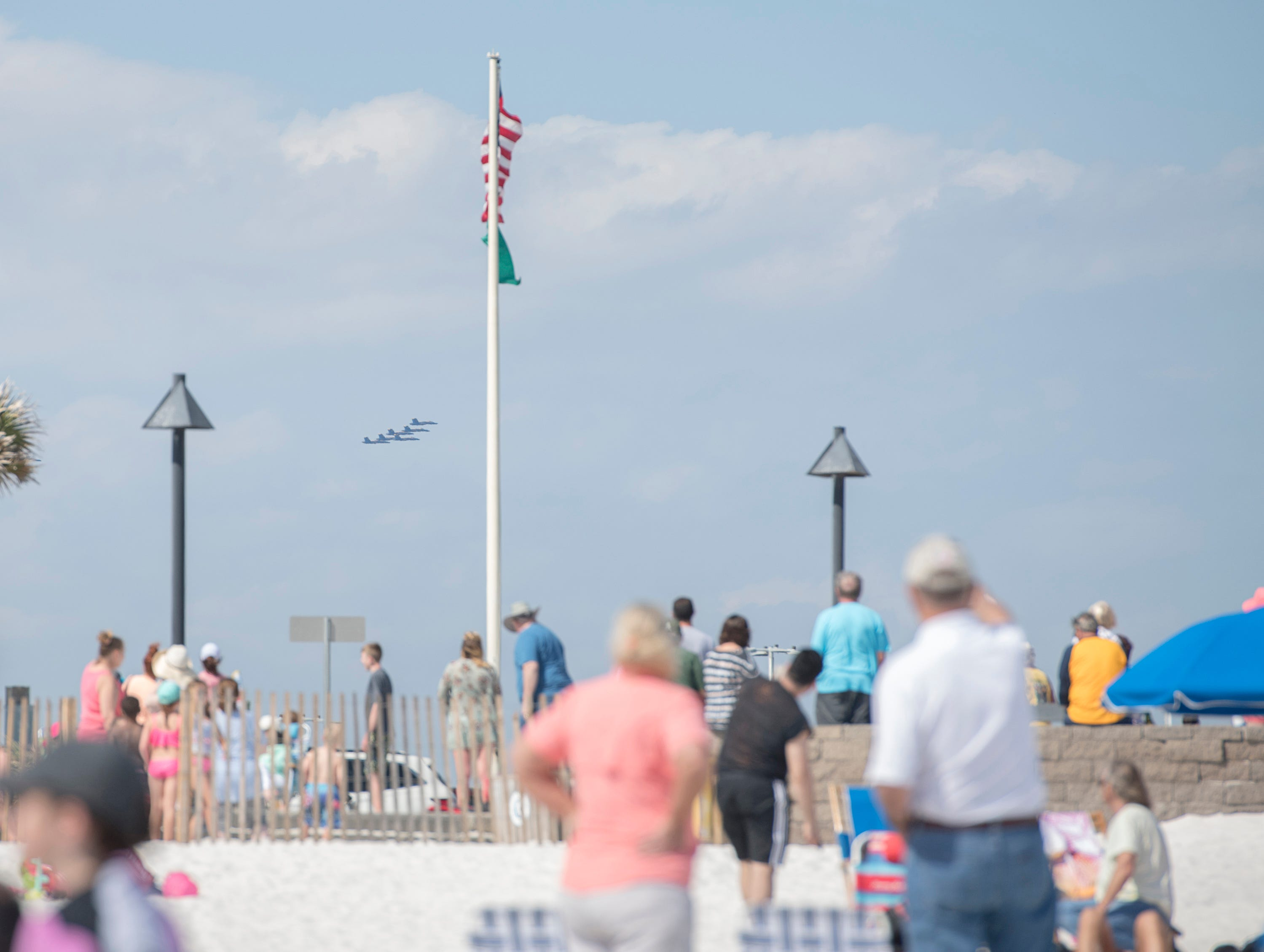 The crowd spots the Blue Angels in the distance as they get ready to fly over Pensacola Beach on Monday, March 25, 2019.  The Blue Angels are coming home from winter training in El Centro, California.