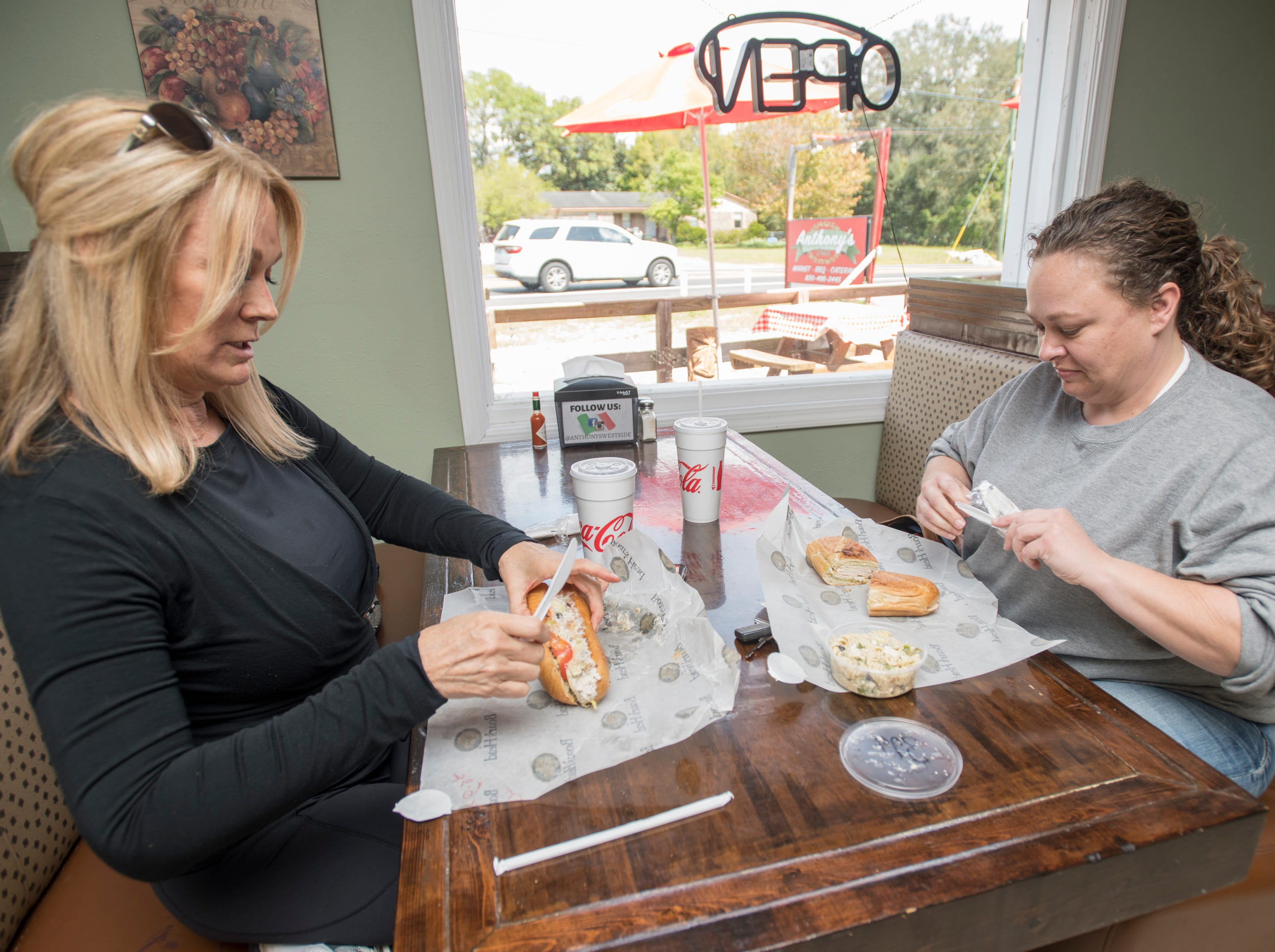 Jennifer Carlisle, left, and Monica Allen have lunch at Anthony's Deli on Lilian Highway in Pensacola on Monday, March 25, 2019.