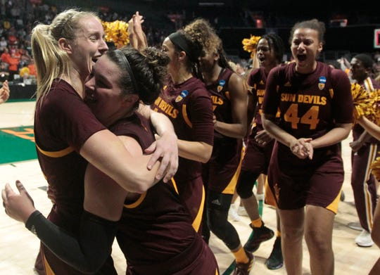 Arizona State's Courtney Ekmark, left, hugs teammate Robbi Ryan, right, after the Sun Devils defeated Miami 57-55 during a second round women's college basketball game in the NCAA Tournament, Sunday, March 24, 2019, in Coral Gables, Fla. (AP Photo/Luis M. Alvarez)