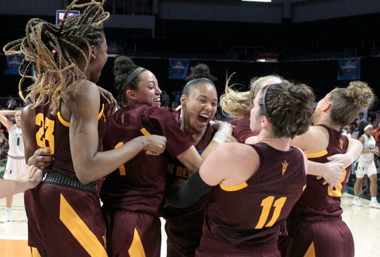 Arizona State players celebrate after defeating Miami 57-55 during a second round women's college basketball game in the NCAA Tournament, Sunday, March 24, 2019, in Coral Gables, Fla. (AP Photo/Luis M. Alvarez)