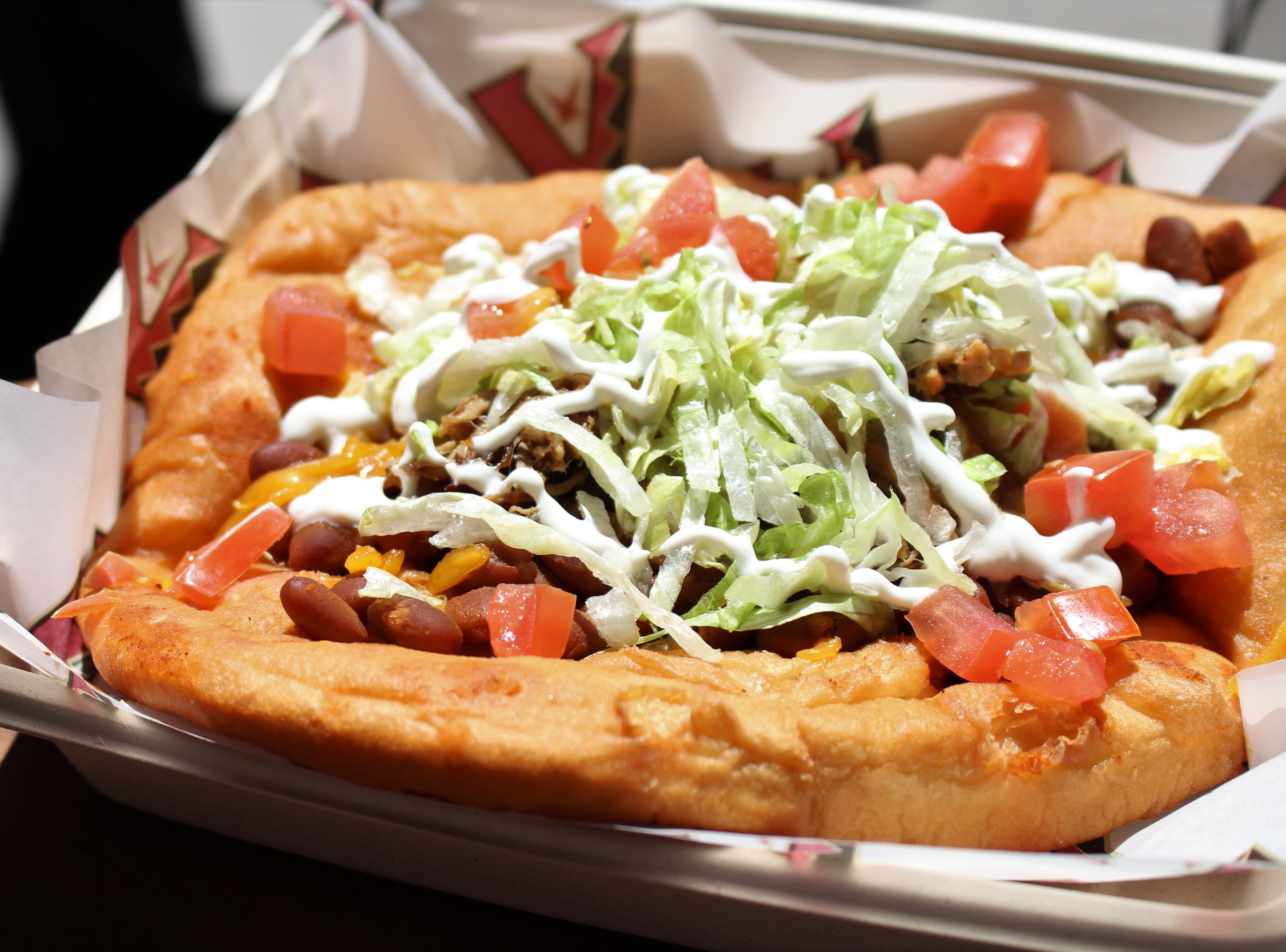 New to Chase Field: The 505 Fry Bread Taco. A fry bread shell topped with ranch beans, carnitas, 505 Southwestern green chile sauce, Cheddar cheese, lettuce, tomato and sour cream. Available for $14 at Taste of Chase.