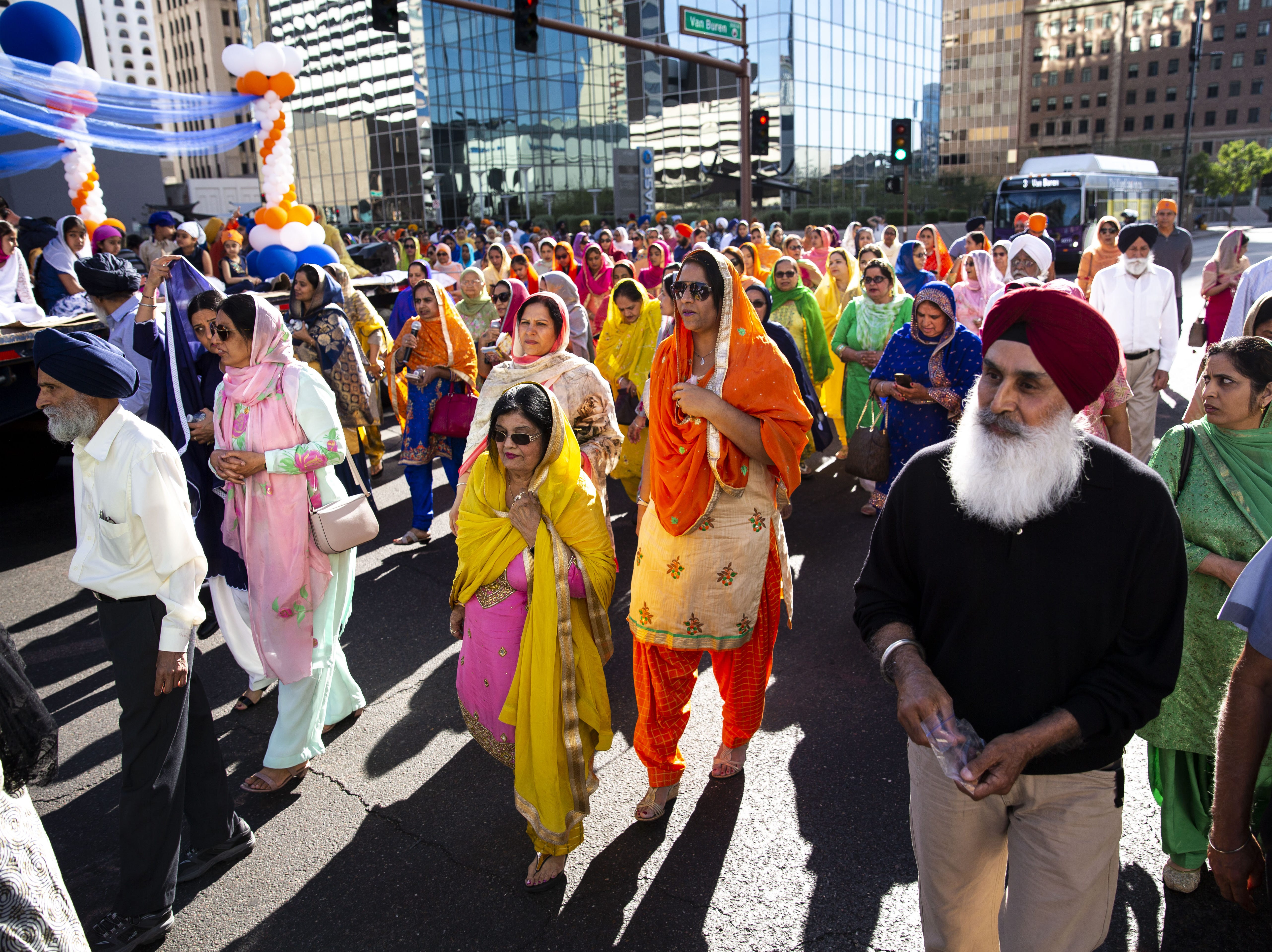 A crowd dressed in traditional clothing marches along with a Nagar Kirtan procession in downtown Phoenix on March 24, 2019.