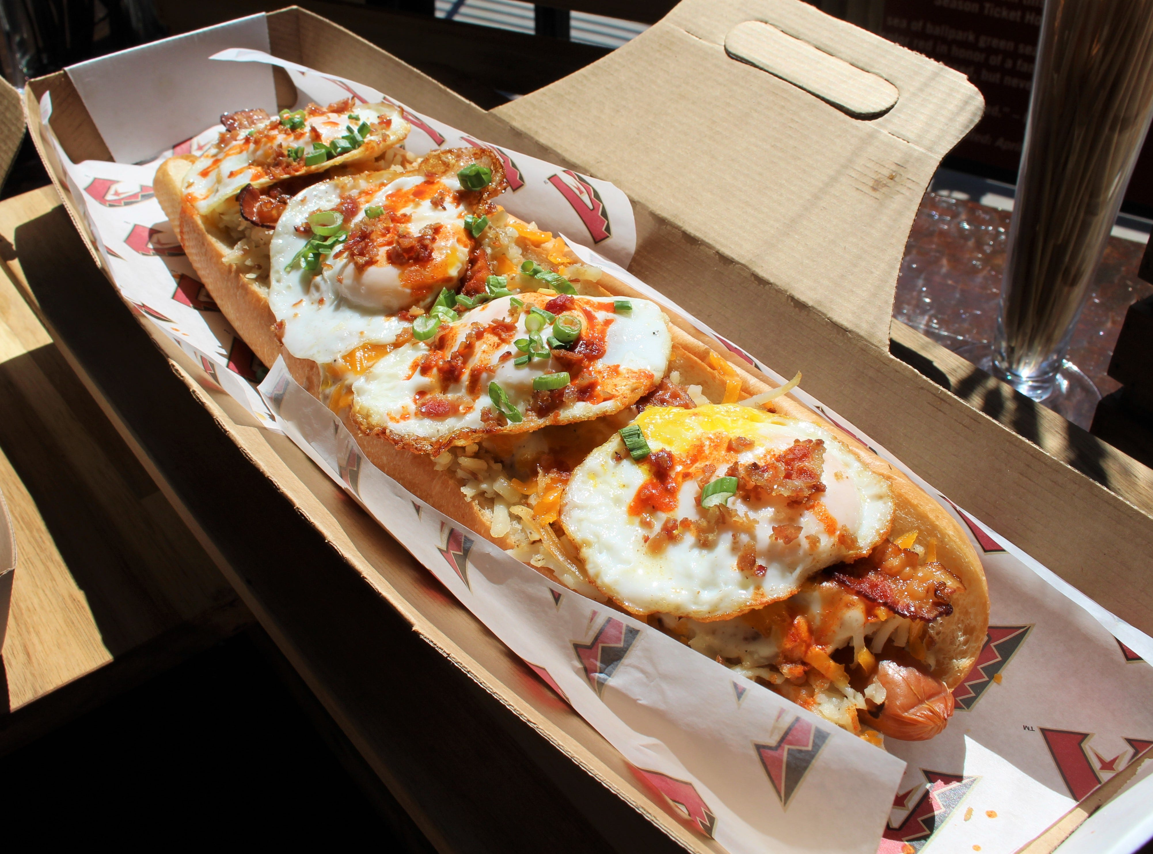 New to Chase Field: The All Day Breakfast Dog made with an 18-inch Schreiner's hot dog topped with hash browns, country gravy, Cheddar cheese, bacon, fried eggs, Tapatío hot sauce and green onion. Available for $30 in April and May only at Big Dawgs.