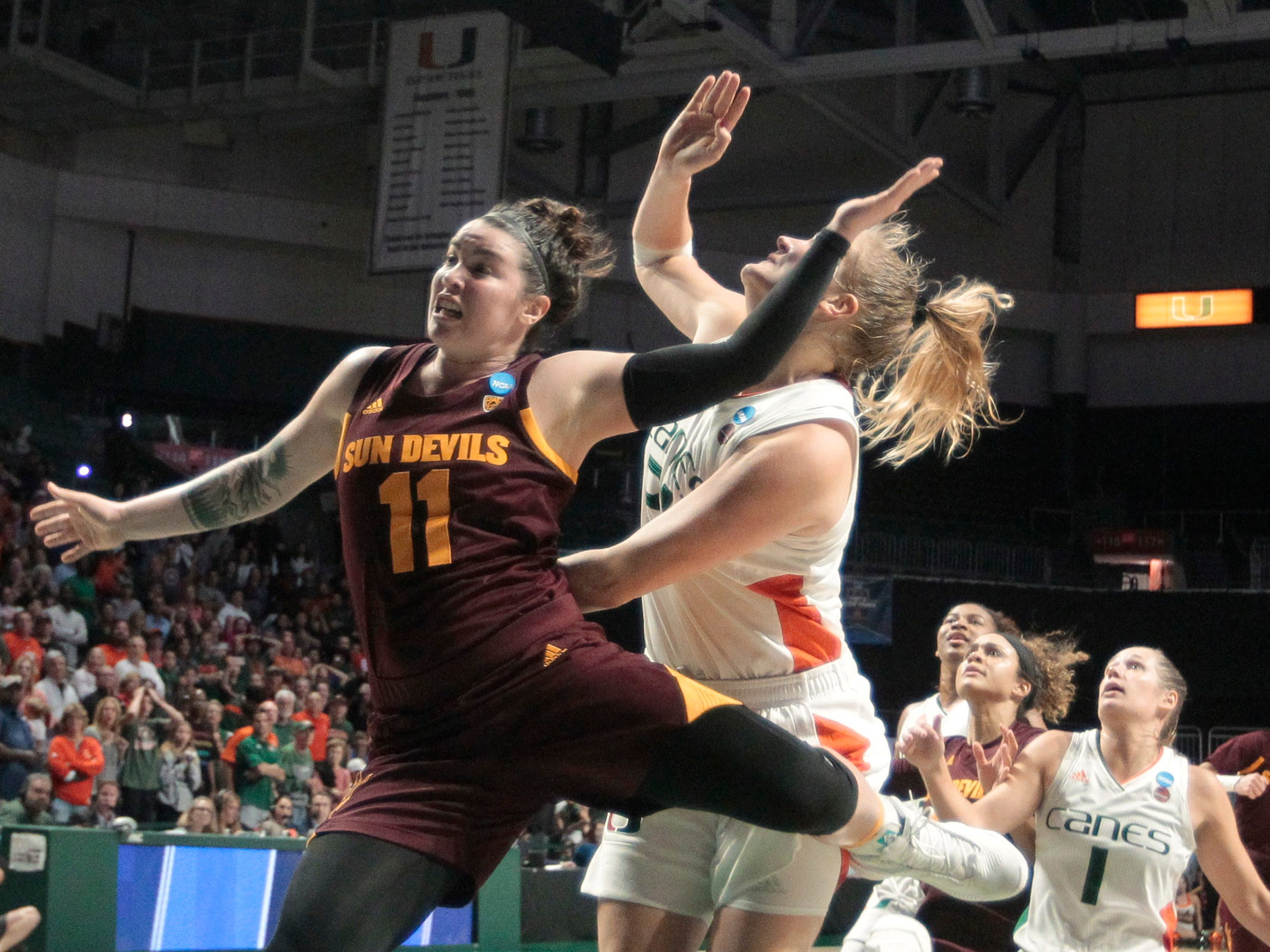 Arizona State's Robbi Ryan (11) is fouled by Miami's Emese Hof, right, as she attempts the go-ahead shot during the closing seconds of a second-round women's college basketball game in the NCAA Tournament, Sunday, March 24, 2019, in Coral Gables, Fla. Arizona State won 57-55. (AP Photo/Luis M. Alvarez)