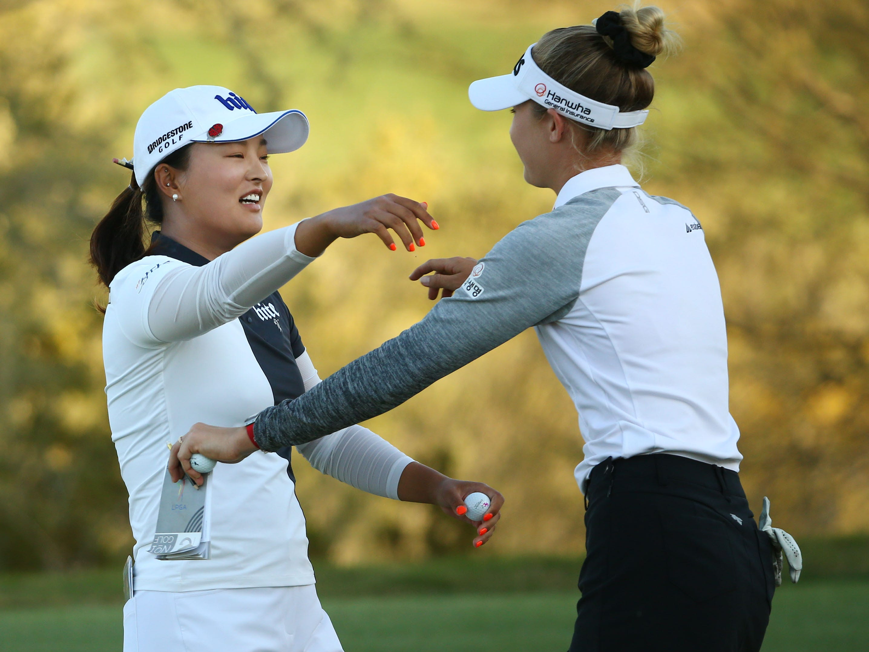 Jin Young Ko of South Korea hugs playing partner Nelly Korda (right) after finishing their final round at the Bank of Hope Founders Cup on Mar. 24, 2019 at Wildfire Golf Club at JW Marriott in Phoenix, Ariz.