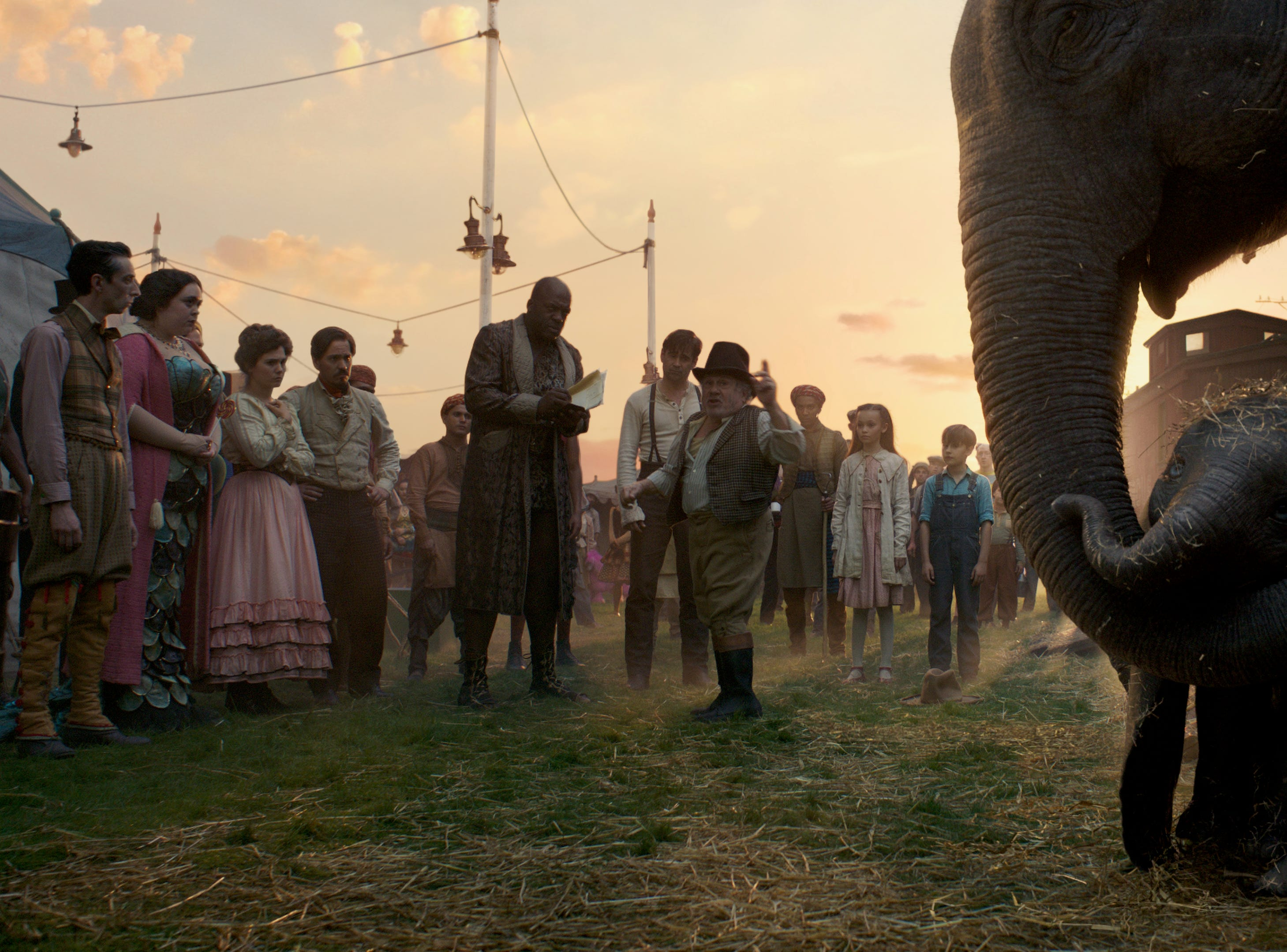 "Max Medici (Danny DeVito) and circus performer Rongo the Strongo (Deobia Oparai) welcome a newborn elephant with oversized ears to the clan in ""Dumbo."""