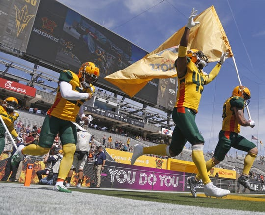 Rahim Moore (45) of the Arizona Hotshots celebrates as he runs with his team onto the field at Sun Devil Stadium on March 24.