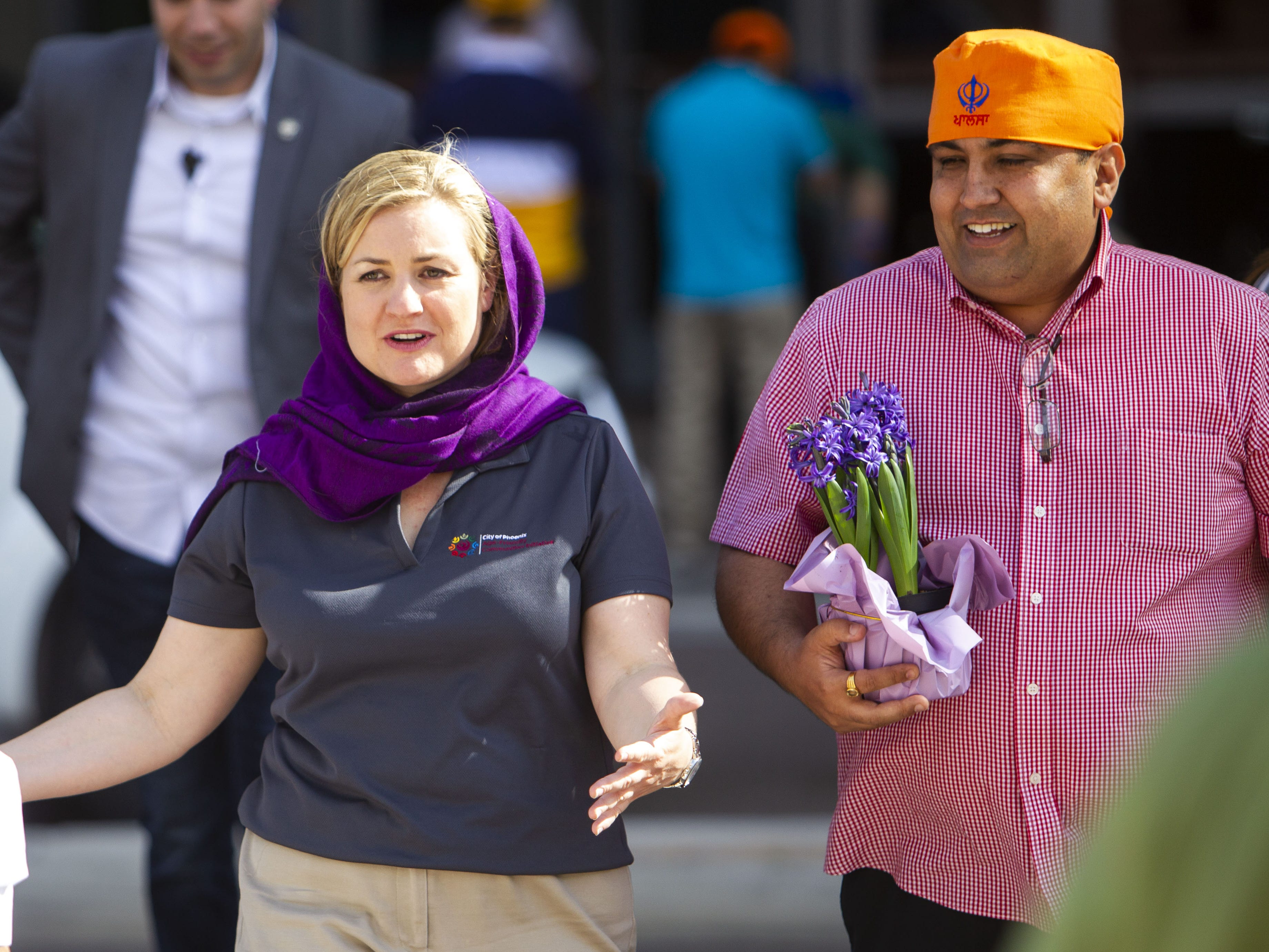 Phoenix Mayor Kate Gallego walks with Dr. Vishal Verma, right, after speaking in the Phoenix Convention Center on March 24, 2019.