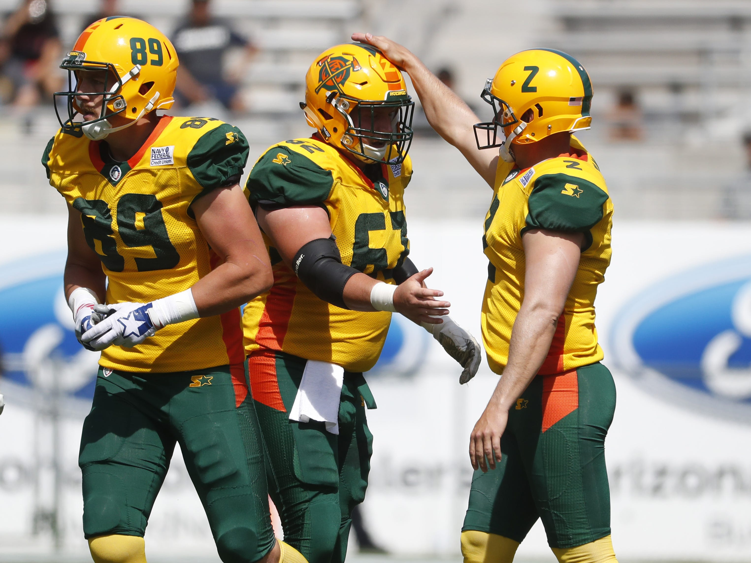 Hotshot's Jacob Ohnesorge (62) celebrates with Nick Folk (2) after Folk made a field goal during the first half at Sun Devil Stadium in Tempe, Ariz. on March 24, 2019.