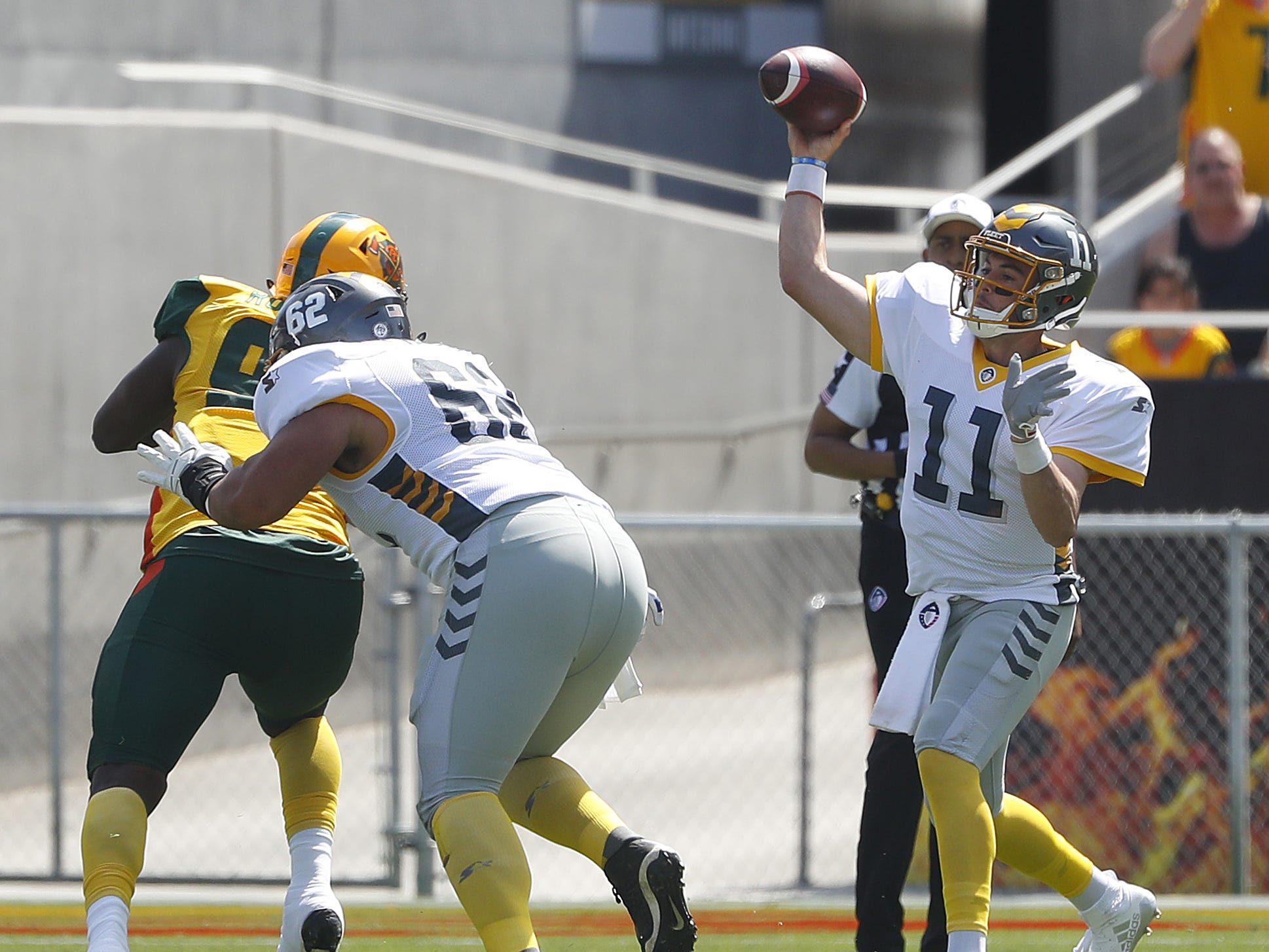 Fleet's Mike Bercovici (11) throws a pass against the Hotshots during the first half at Sun Devil Stadium in Tempe, Ariz. on March 24, 2019.