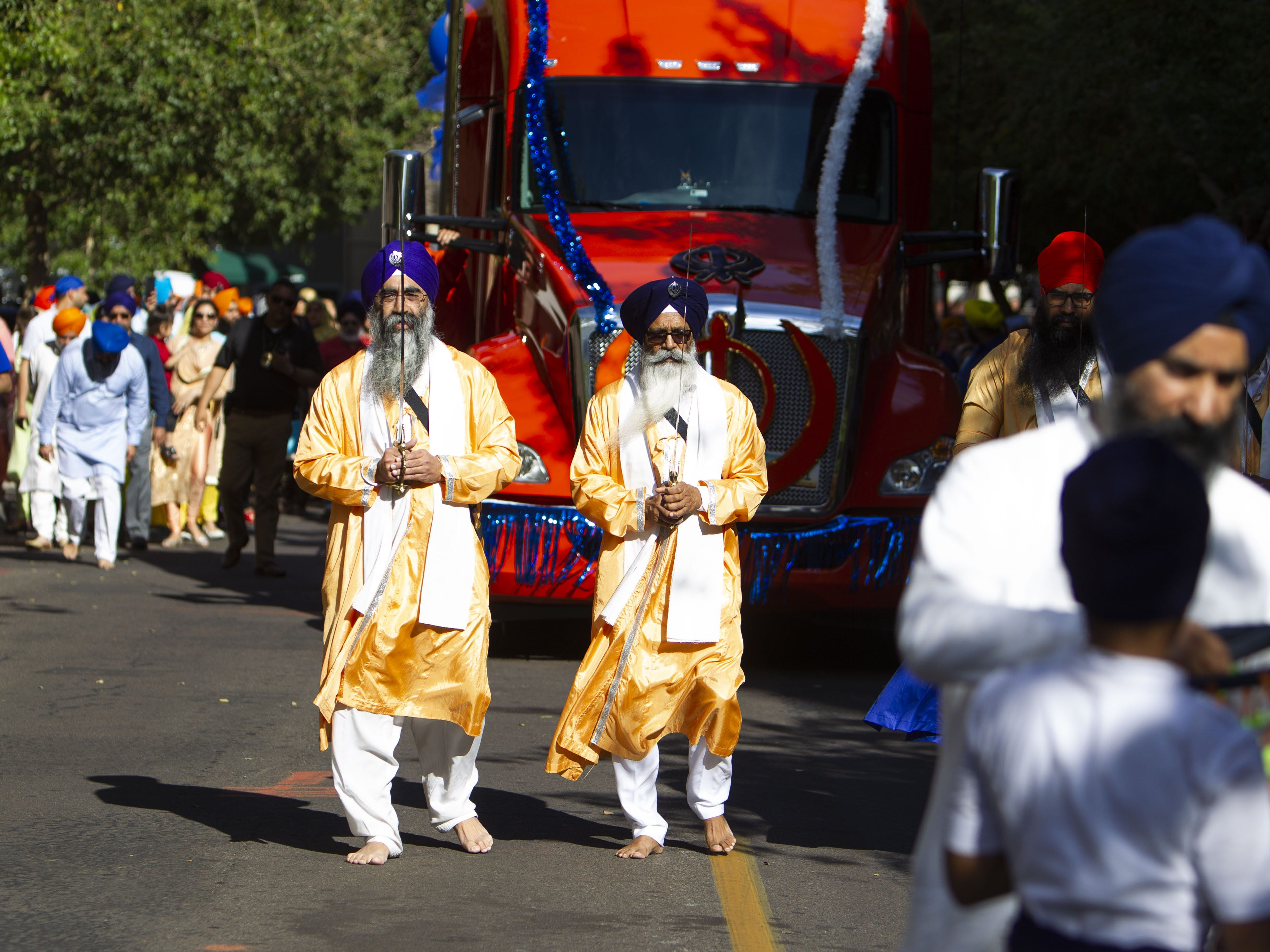 From left, Raj Rekhi and Gurbax Singh are two of the Panj Pyare who lead the Nagar Kirtan procession through downtown Phoenix on March 24, 2019.